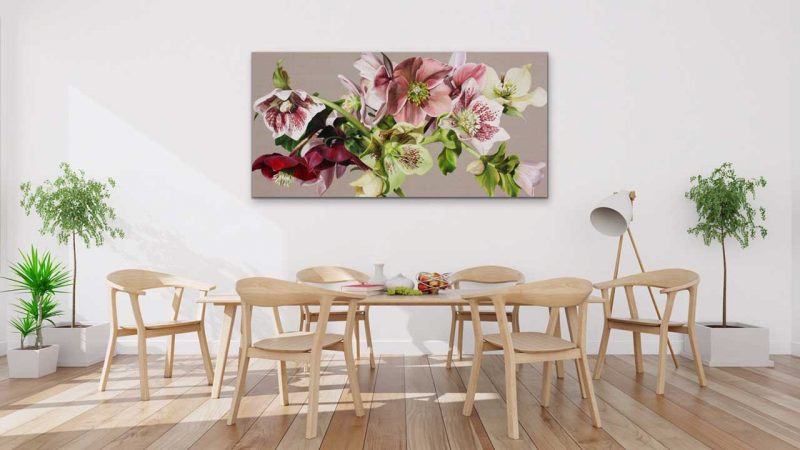 Canvas print of pink and white and green hellebores on linen background on a wall in a dining room. Painting by UK floral artist Sarah Caswell