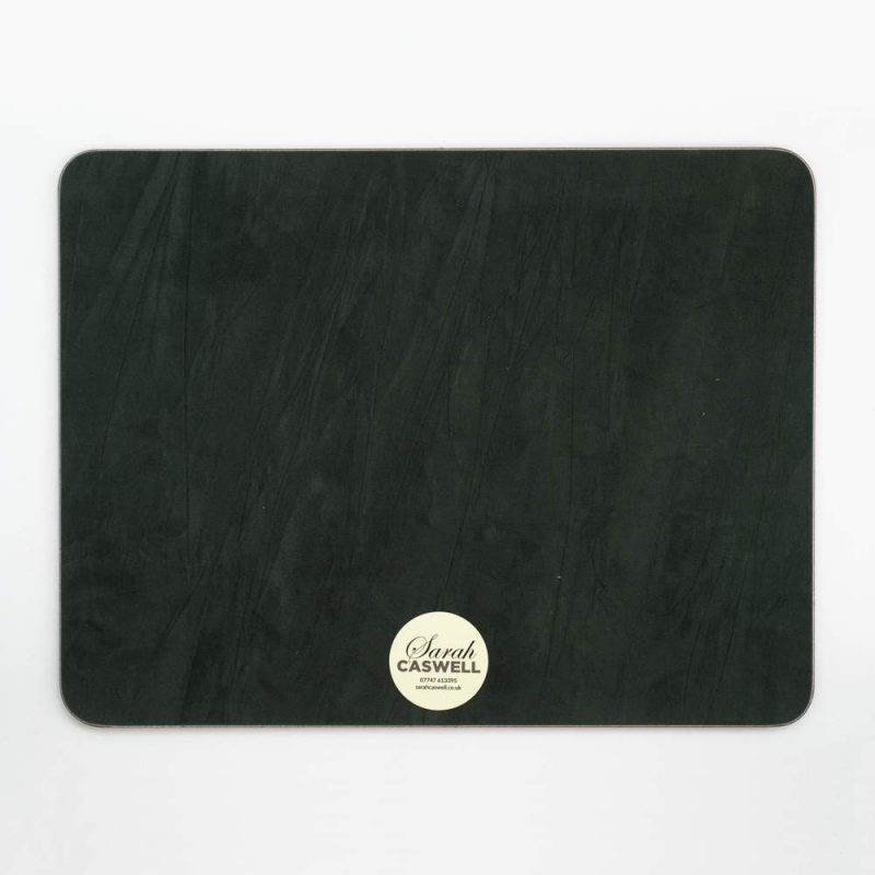 Green baize backing of oblong melamine tablemat