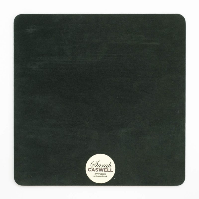 Green baize backing of square melamine tablemat