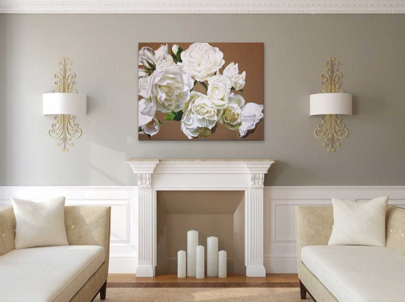 Canvas print of white roses on linen background on a wall in a living room. Painting by UK floral artist Sarah Caswell