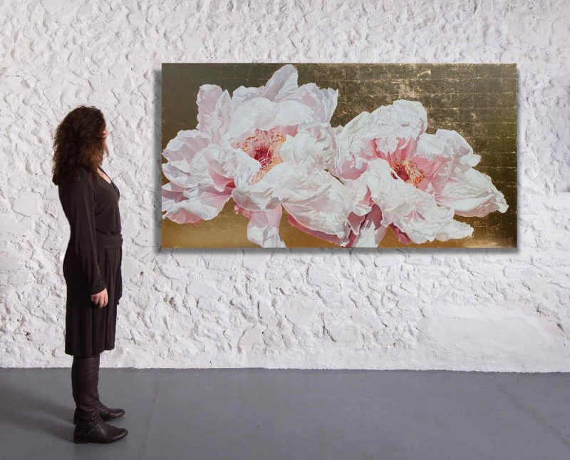 Original acrylic painting on gold leaf background by Sarah Caswell of Tree peonies in bright sunshine. Shown in a gallery setting.