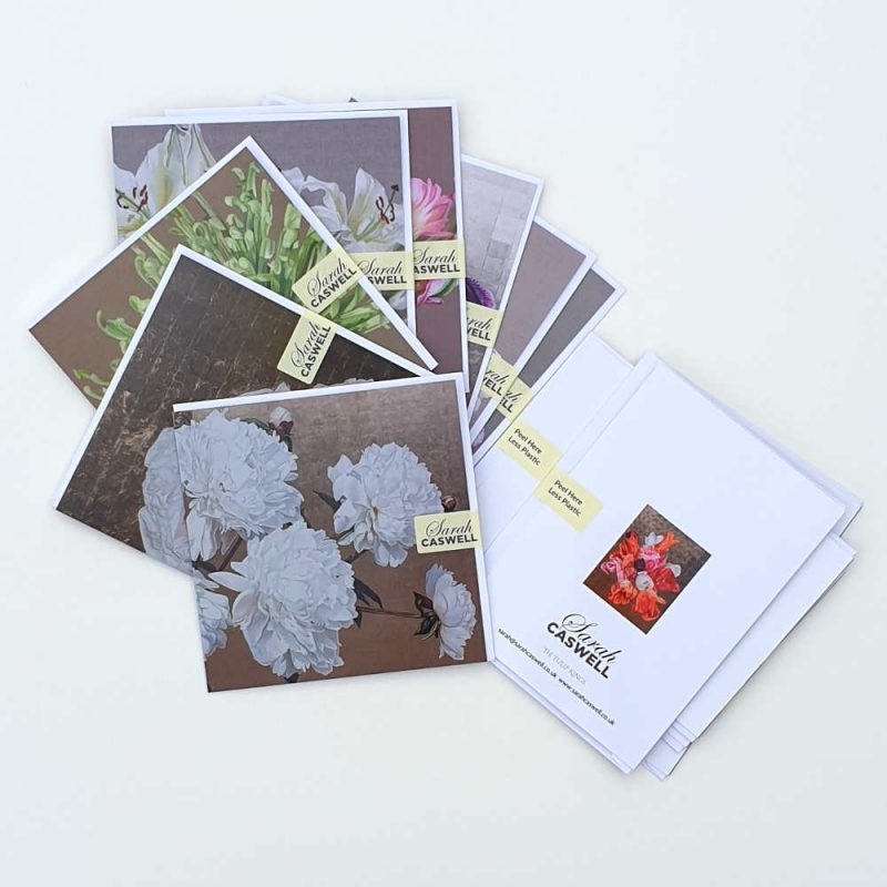 Selection of greetings cards and envelopes secured with a removable sticky label