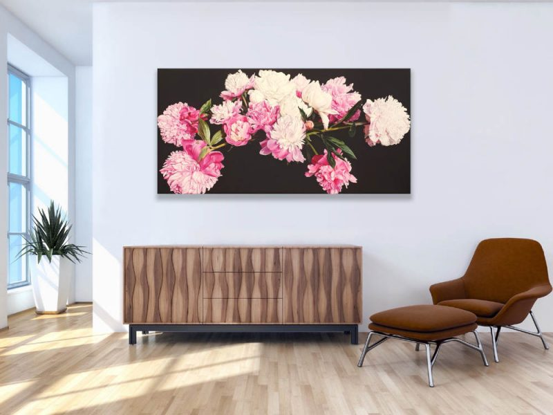 Original acrylic painting by floral artist Sarah Caswell. Pink and white peonies in bright sunshine on dark brown background shown in a home setting.