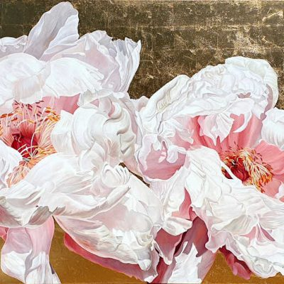 Tree peonies in bright sunshine on gold leaf