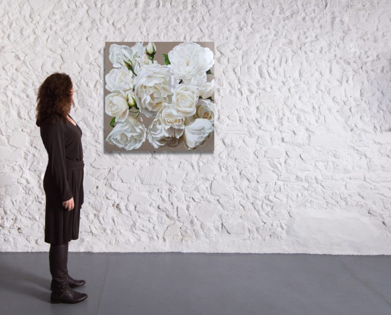 Print of original acrylic painting by Sarah Caswell of white roses in bright sunshine on a linen background. Shown in a gallery setting.